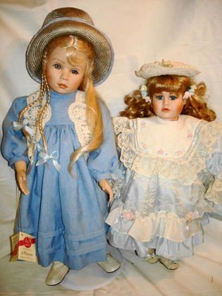 14: 2 pc. Porcelain dolls