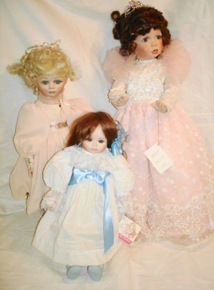 18: 3 pc Porcelain dolls