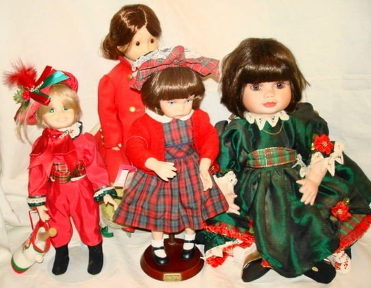 23: 4 pc Porcelain dolls