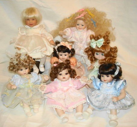 24: 7 pc small Porcelain dolls