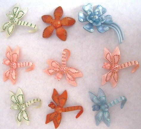 12: Vintage celluloid brooches