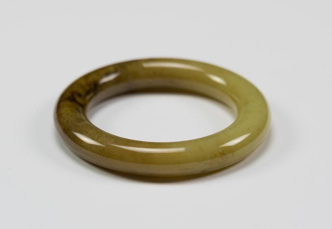 A Yallowish Jade Bangle