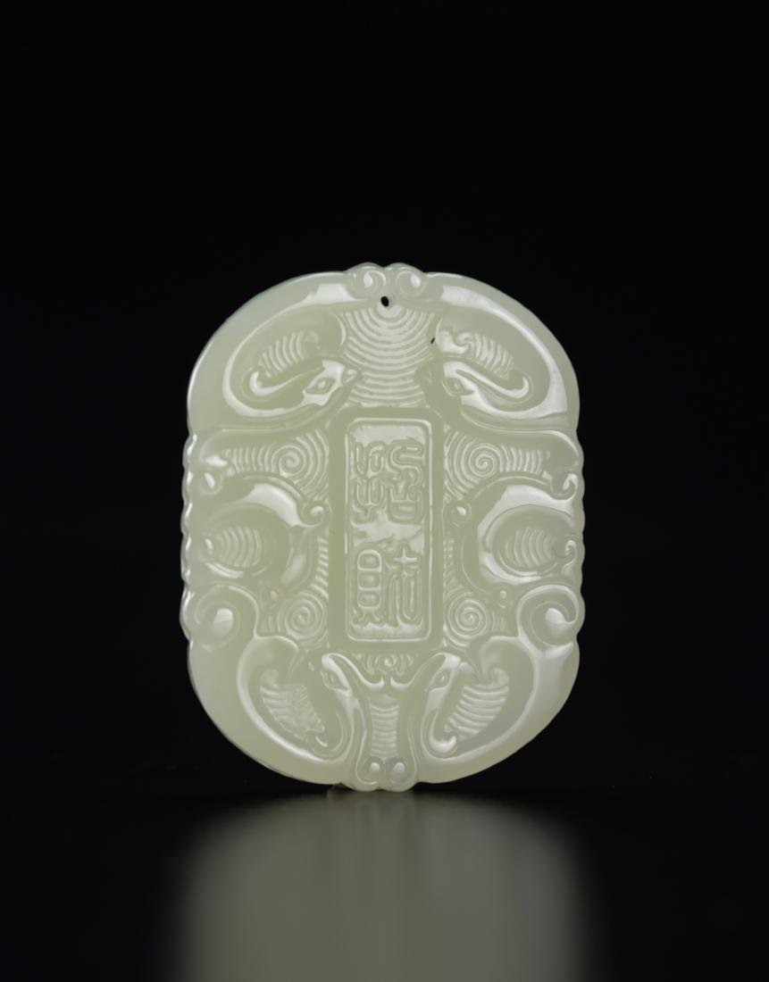 A White Jade Carved Dragon Pendant