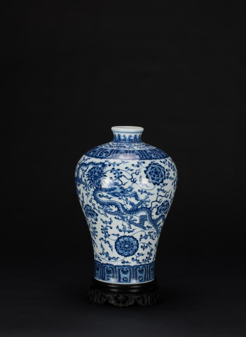 A Blue And White 'Dragon' Vase with Woodstand