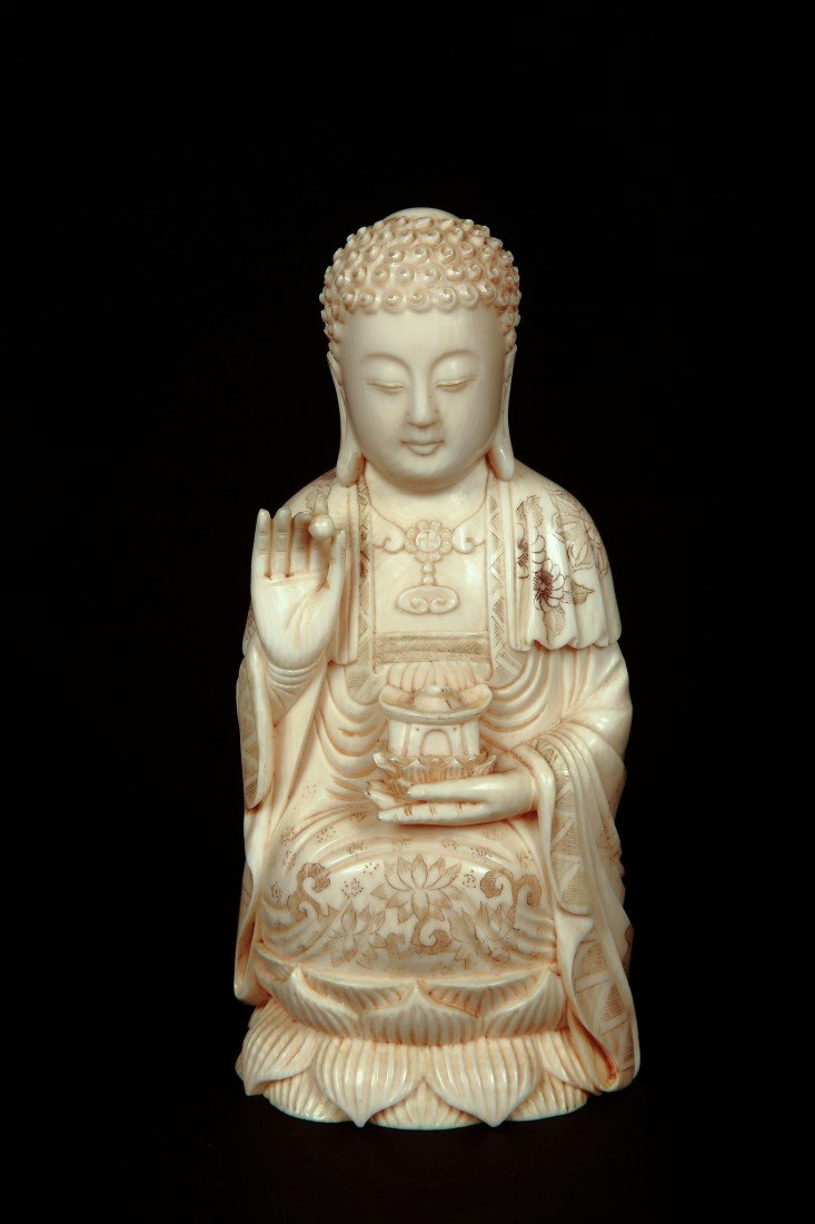 23: 20th Century-A Solid  Ivory Carved Buddha Seated On