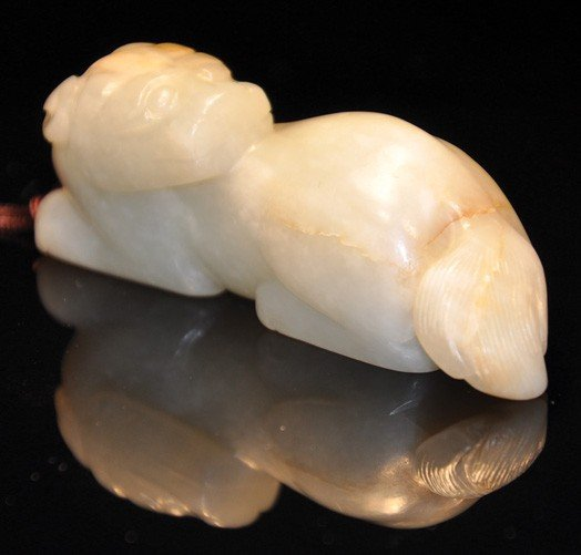 6: Qing. A white jade carved beast