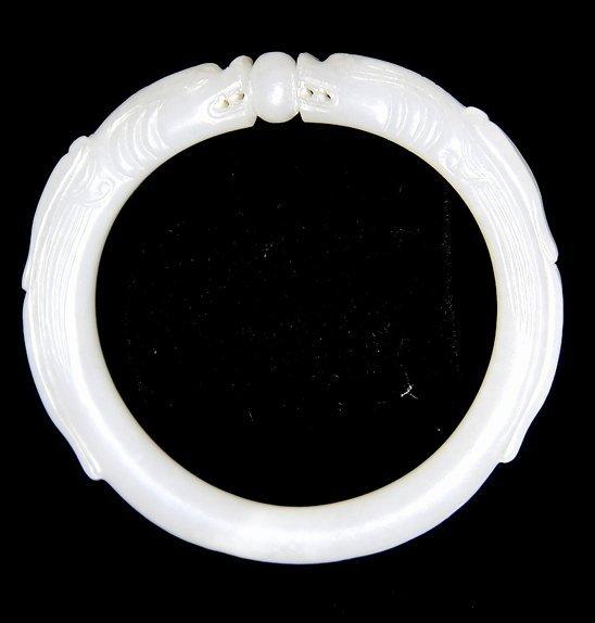 3119: A fine white jade carved dragon bangle