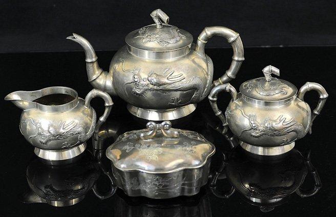 3158: A silver set includes teapot, sugar jug, milk jug