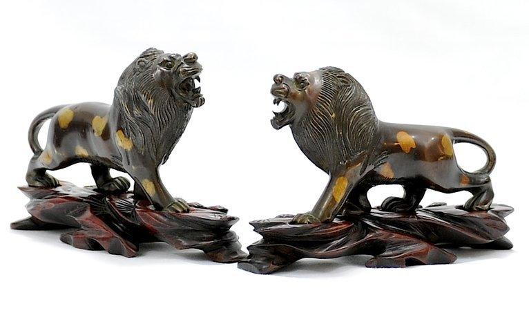 4013: 19th Century. A pair of parcel-gilt Bronze lion