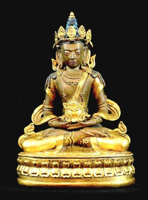 4018: 18th  Century. A gilt-bronze figure of buddha ami