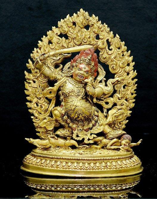 4019: 18th  Century. A gilt-bronze figure of kam sring