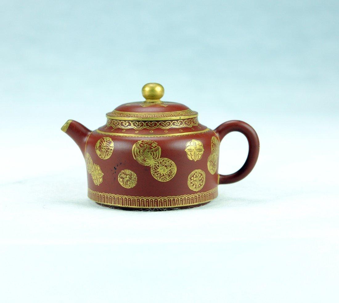 5012: A gilt Zisha Tea pot in Zodiac style