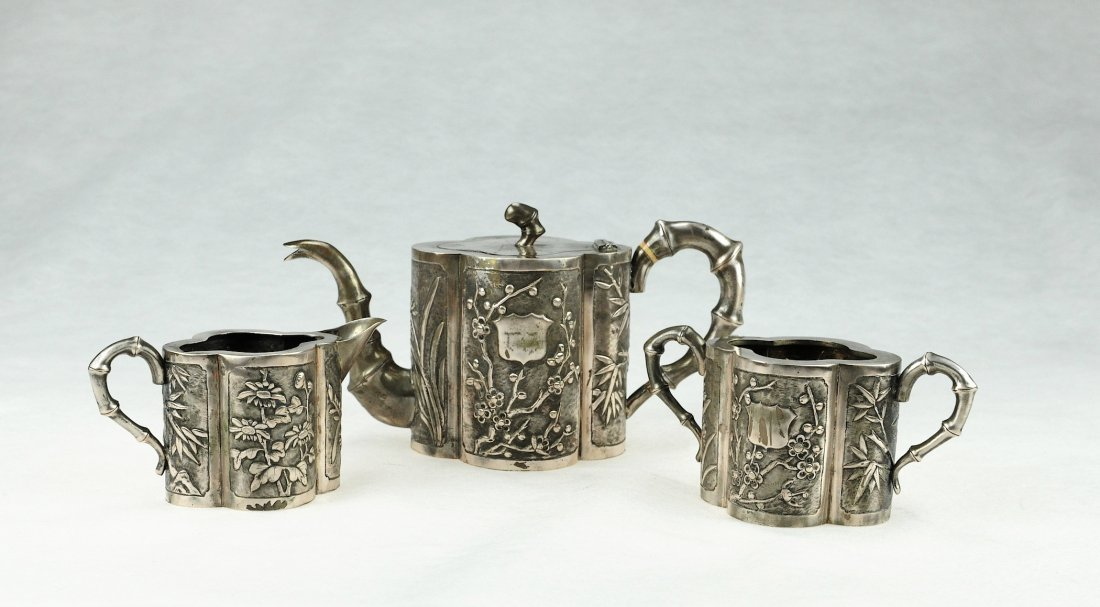 5013: Republic.A set of silver Tea pot carved with flow