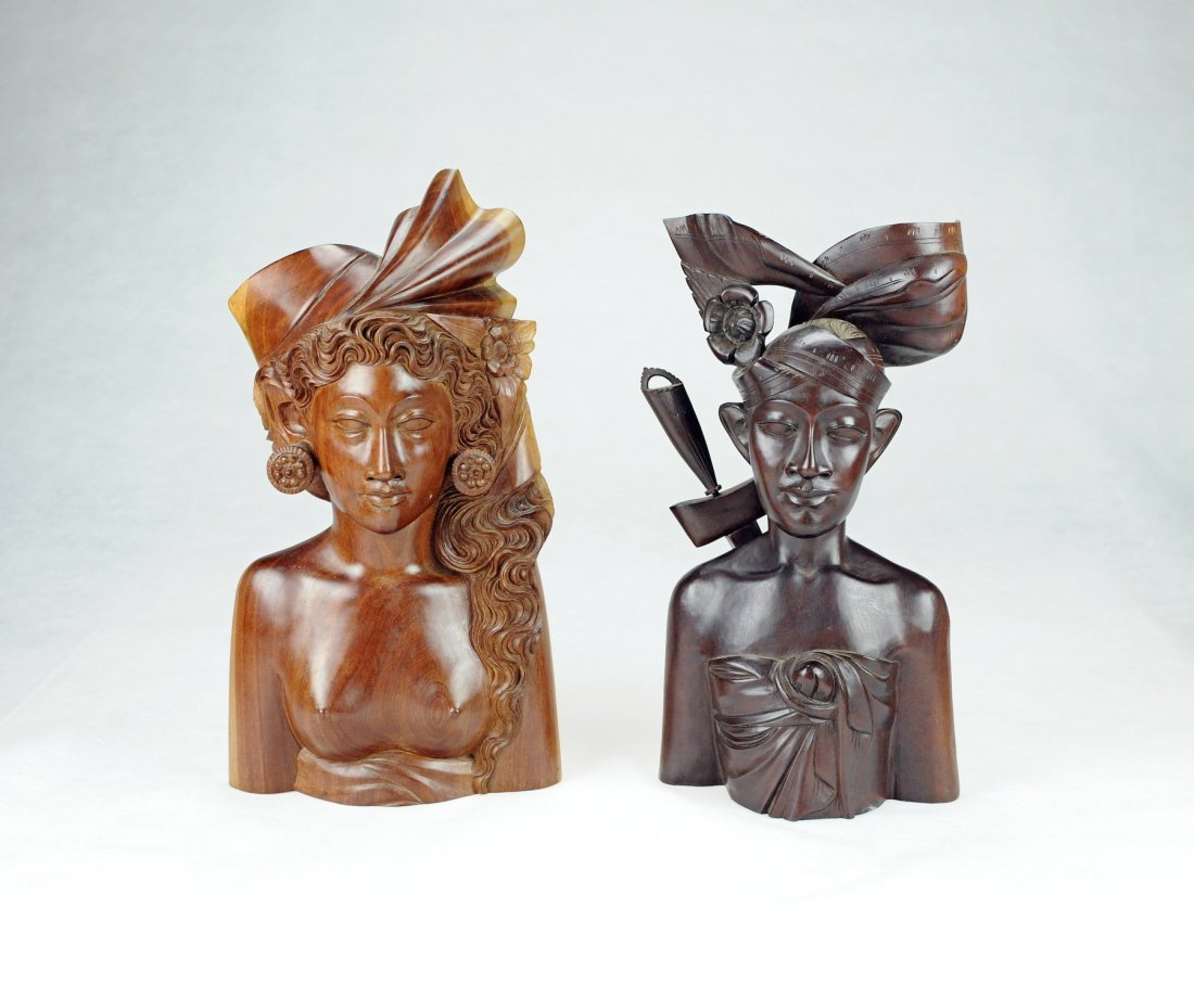 5023: Two indonesia wood carved status