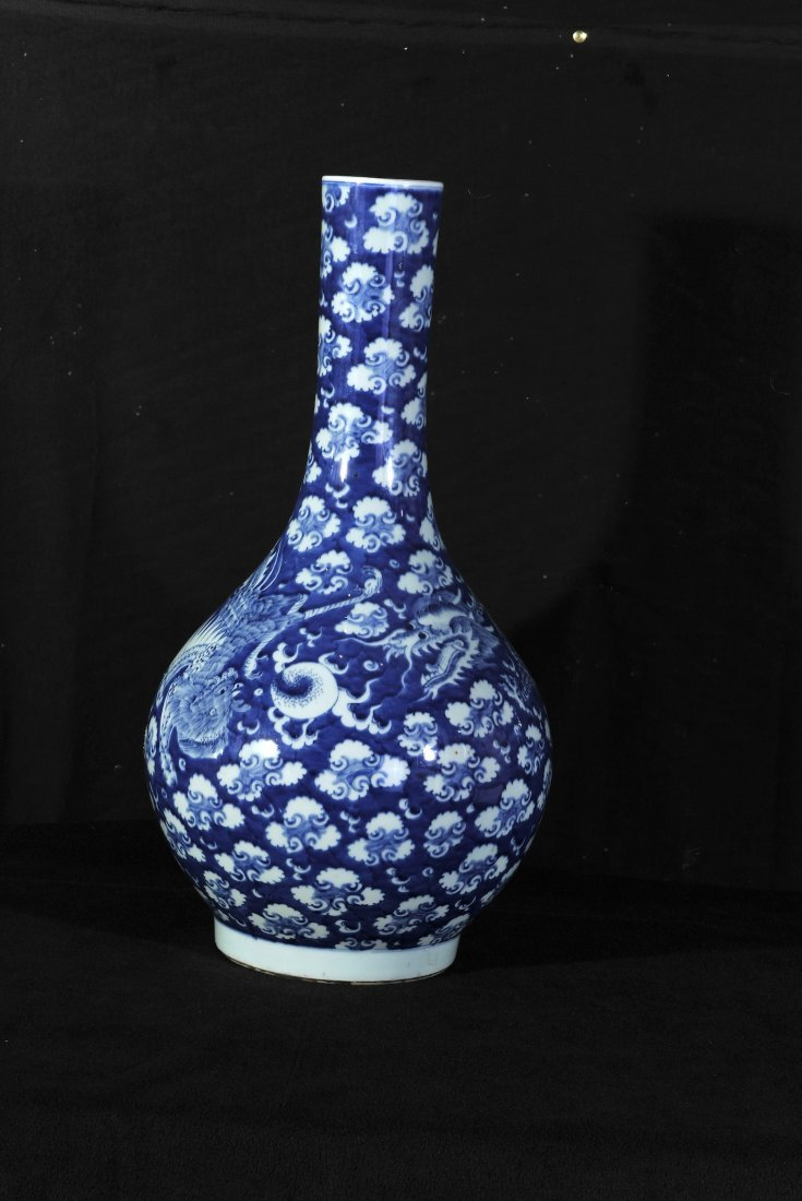 19th Century.A blue and white Dragon and Phoenix vase