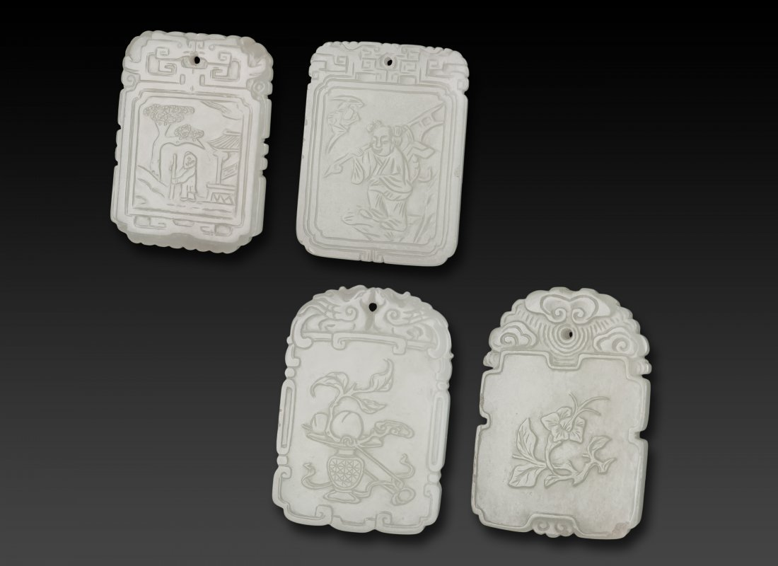 Qing -A Group Of Four White Jade Pendants Carved