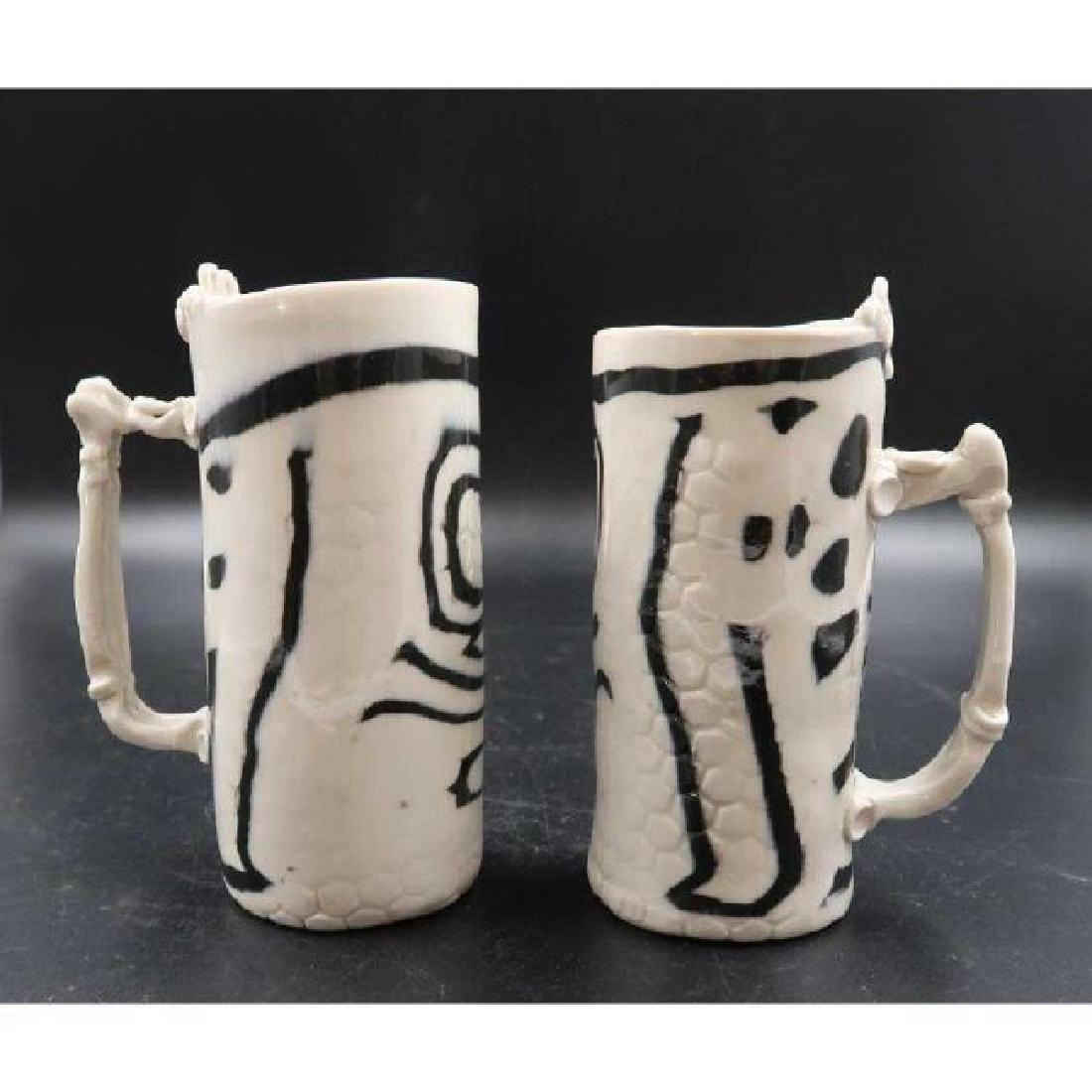 (Pair) signed ceramic mugs