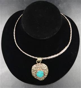 Turquoise pendent from live auctioneers Sterling heavy