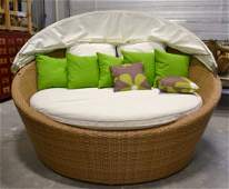 Large rattan outdoor loveseat with retractable canopy