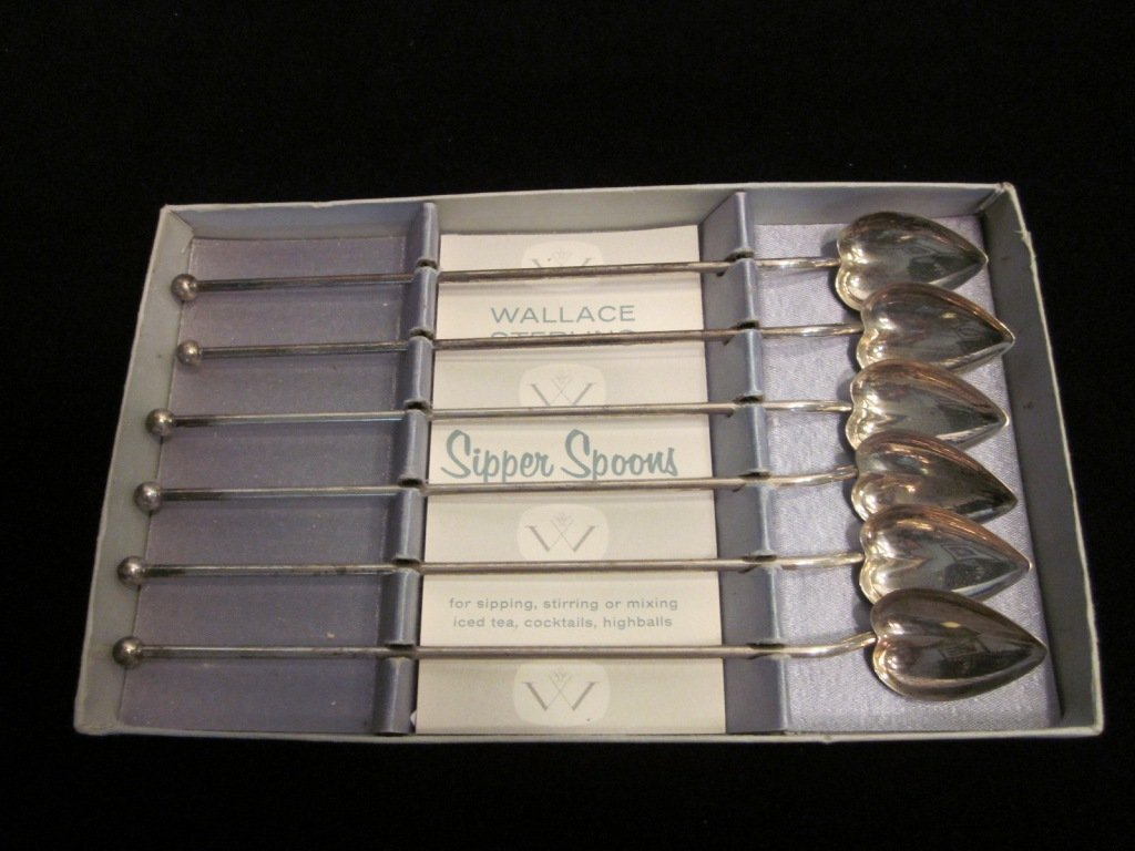151: Sterling Silver Heart Sipper Spoons.