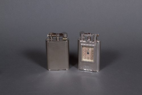 Two Giant Clock lighters, circa 1985
