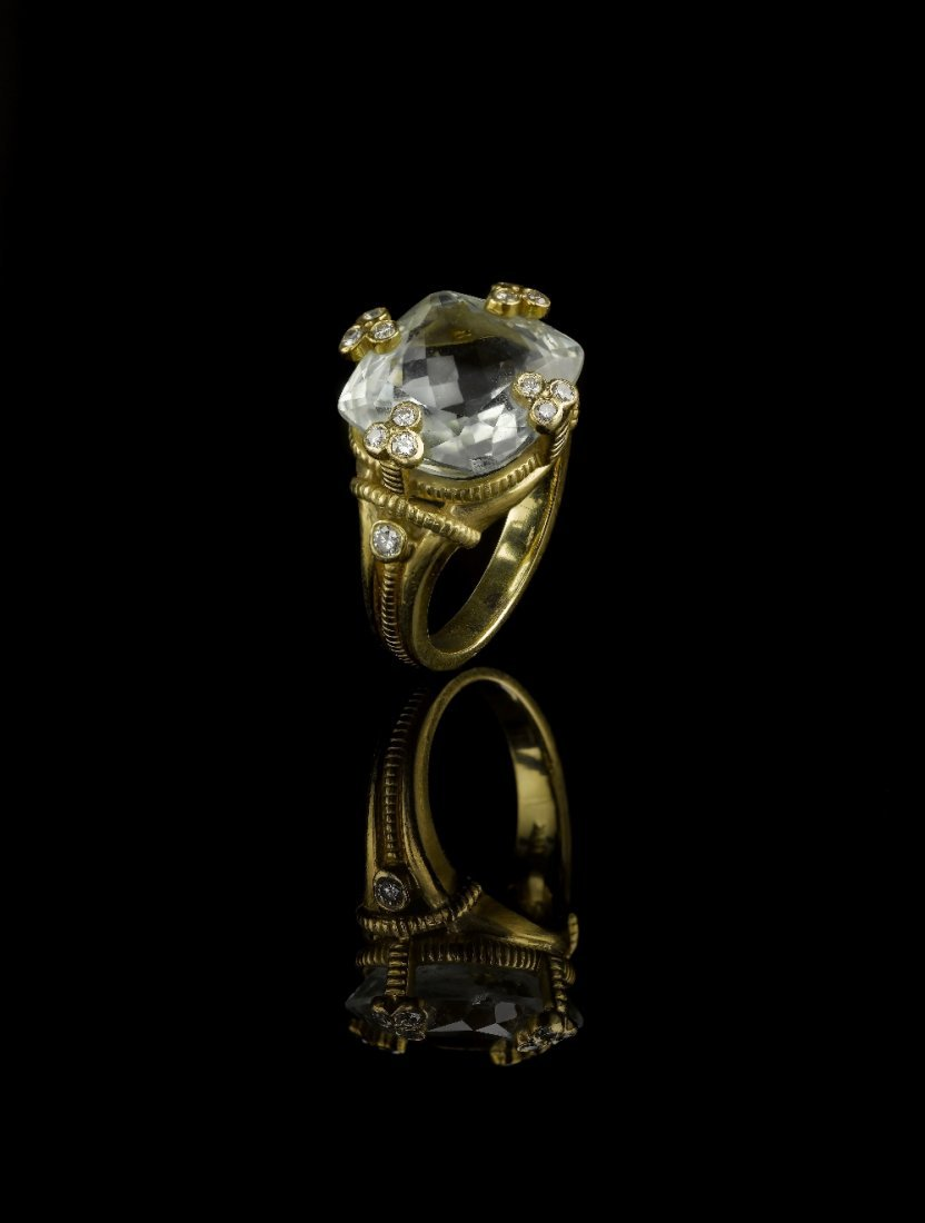 A TOPAZ AND DIAMOND RING, BY RIPKA