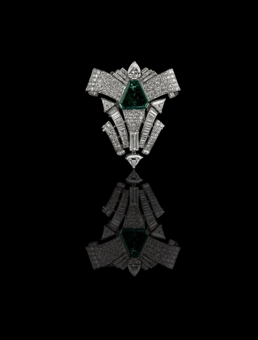 A COLOMBIAN EMERALD AND DIAMOND BROOCH, BY DAVID WEBB