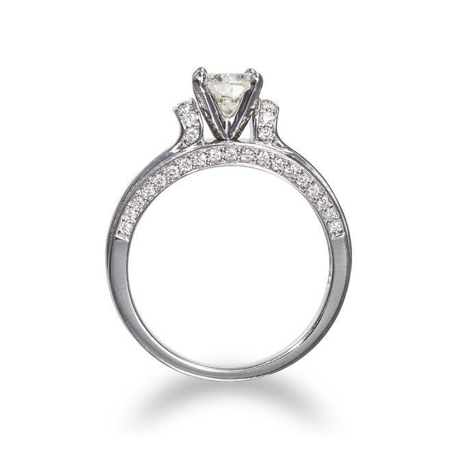 A Diamond Ring Centering a round brilliant-cut diamond,