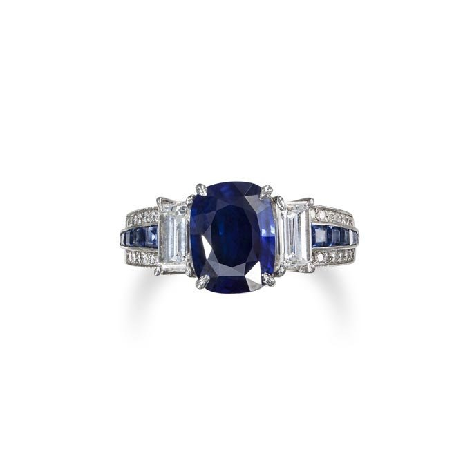 A Sapphire and Diamond Ring Set with an oval-cut