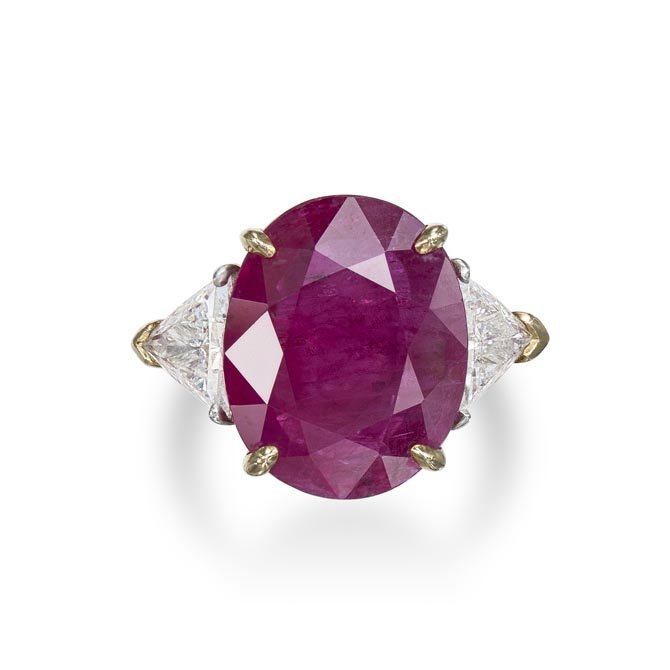 A Ruby and Diamond Ring Centering upon an oval-cut ruby