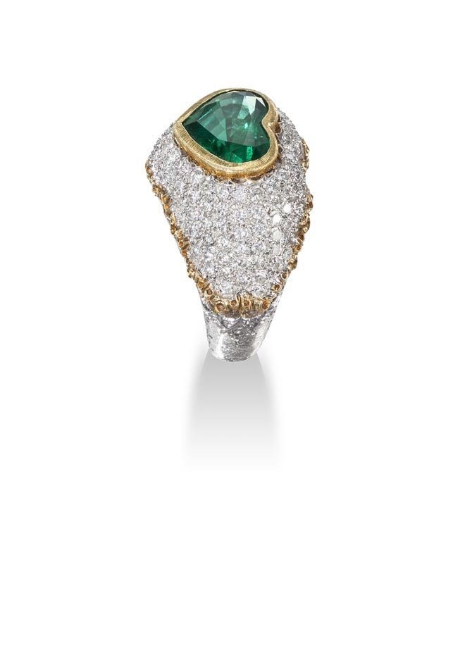 An Emerald and Diamond Ring Centering upon a