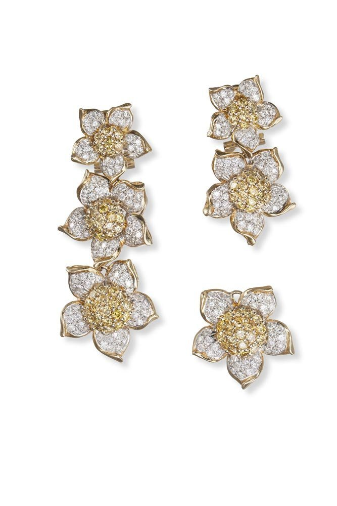 A Pair of White and Yellow Diamond Earrings Each