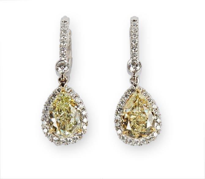 A Pair of Fancy Light Yellow Diamond and Diamond