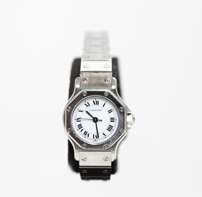 "A Lady's ""Santos Ronde"" Watch, by Cartier"