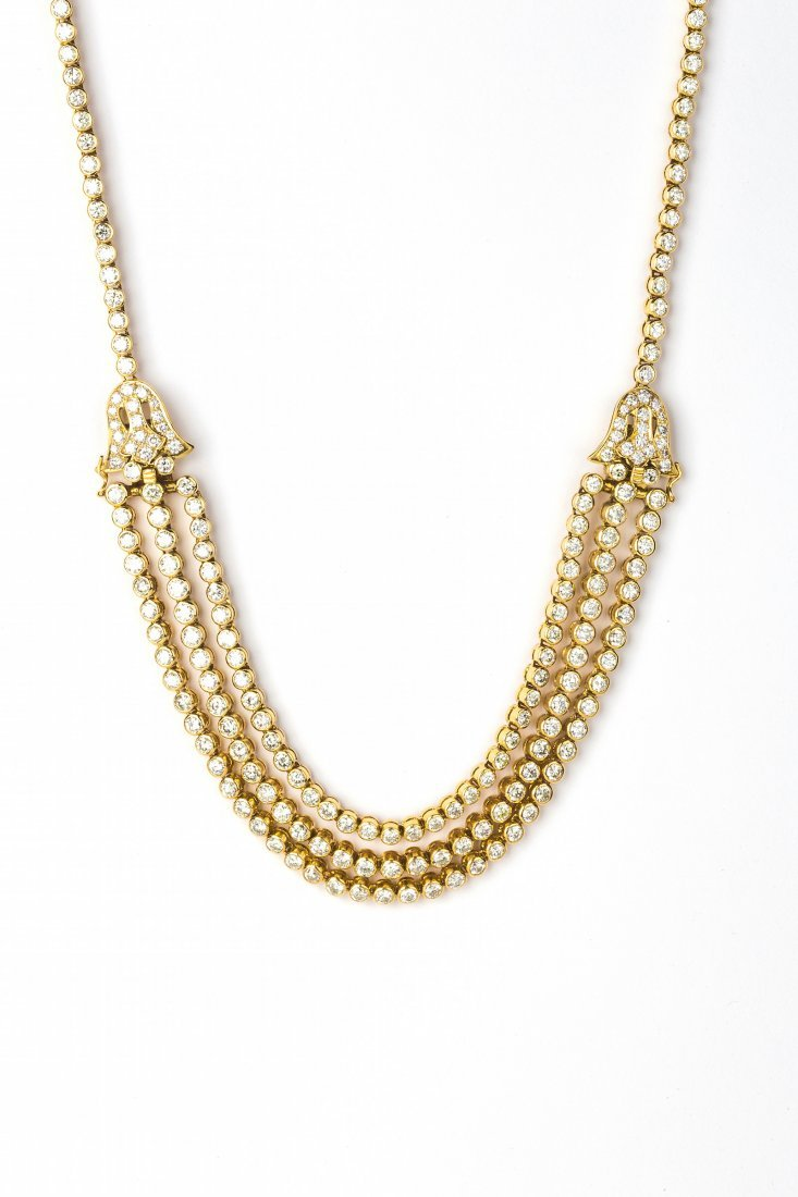 An 18 Karat Gold and Diamond Necklace