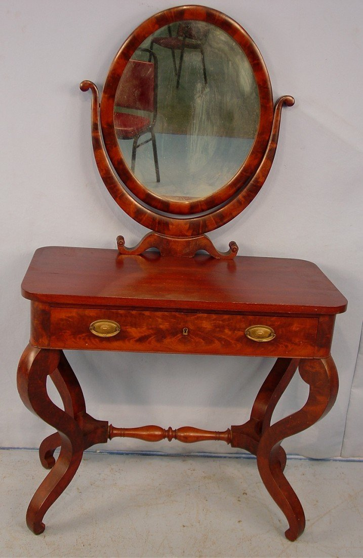 320: Mahogany Empire Vanity with oval mirror, curved le