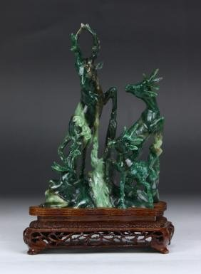 A CHINESE JADEITE CARVED DEER GROUP