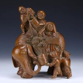A CHINESE ANTIQUE BOXWOOD HUANGYANGMU FIGURE GROUP