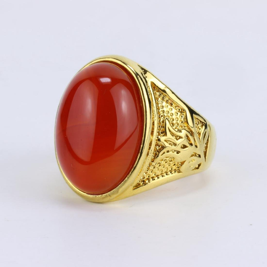 A CHINESE RED JADE OR JADEITE MEN'S RING