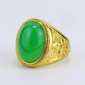 A GREEN JADE OR JADEITE MEN'S RING