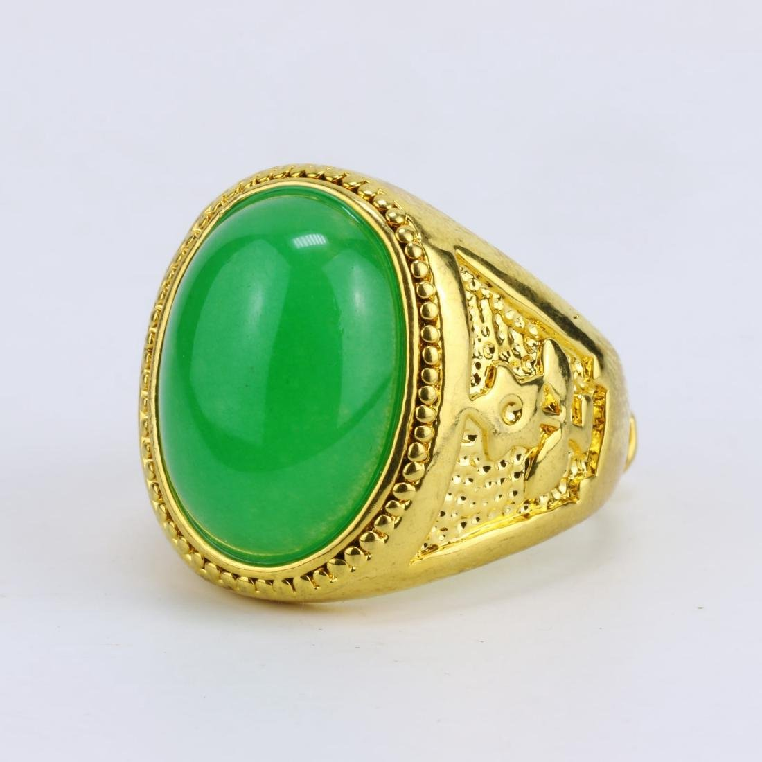 A GREEN JADE OR JADEITE MEN'S RING