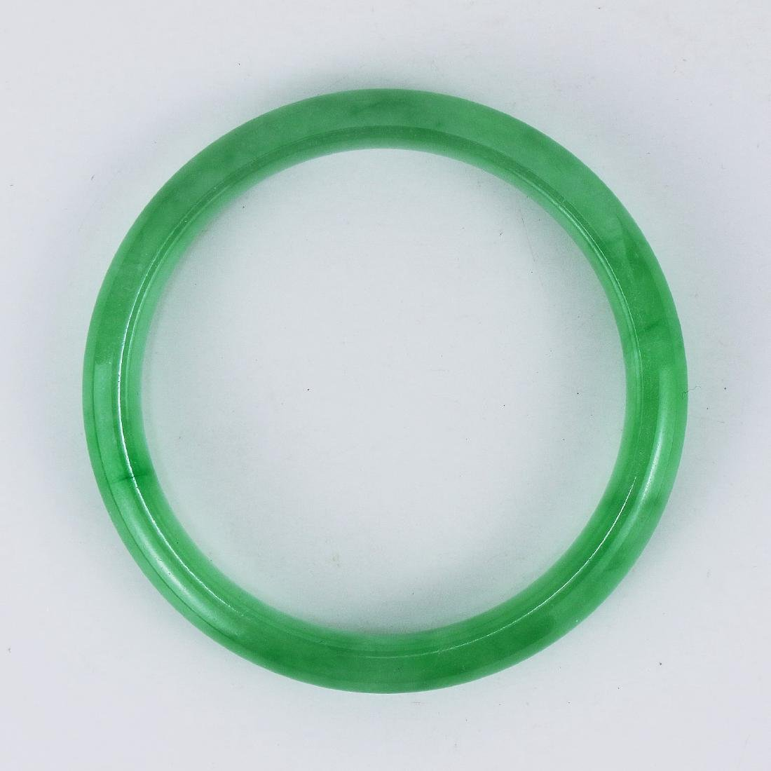 A GREEN JADEITE CARVED BANGLE - 2