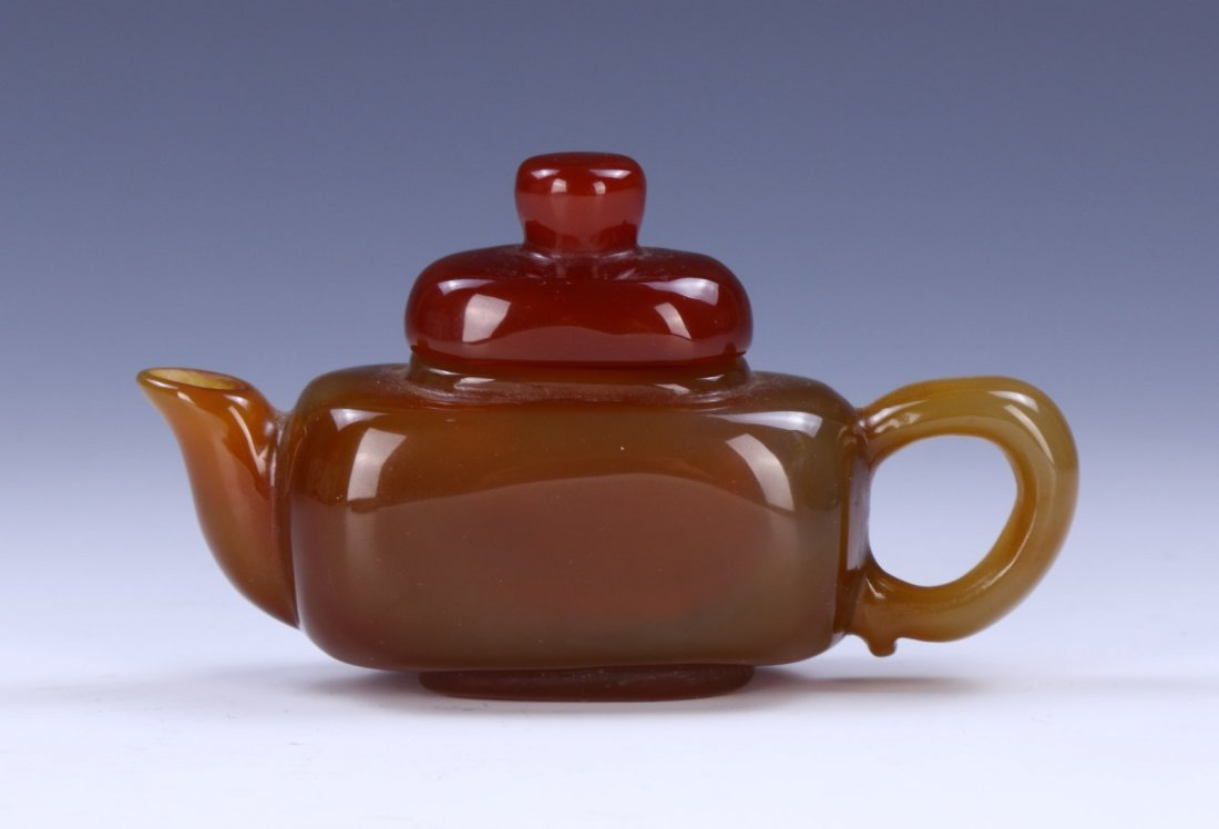 A CHINESE AGATE CARVED TEAPOT