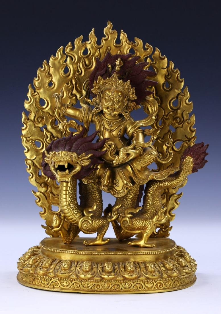 A CHINESE ANTIQUE GILT BRONZE GOD OF WEALTH