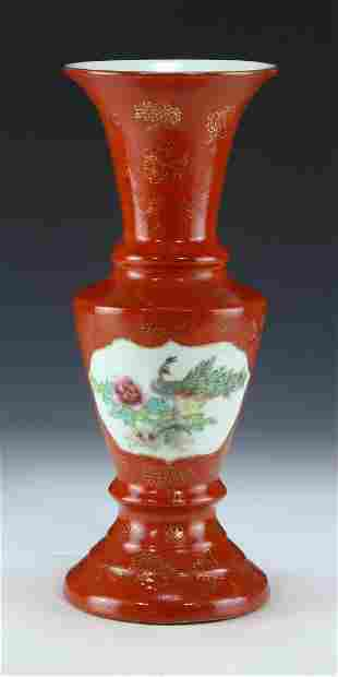 A CHINESE ANTIQUE GILT IRON RED GLAZED PORCELAIN VASE