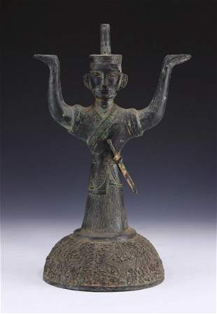 A CHINESE ANTIQUE BRONZE CANDLE HOLDER