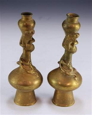 A CHINESE ANTIQUE PAIR OF GILT ON BRONZE CANDLE HOLDERS
