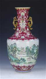 A QIANLONG RUBY-RED-ENAMEL GROUND FAMILLE ROSE VASE