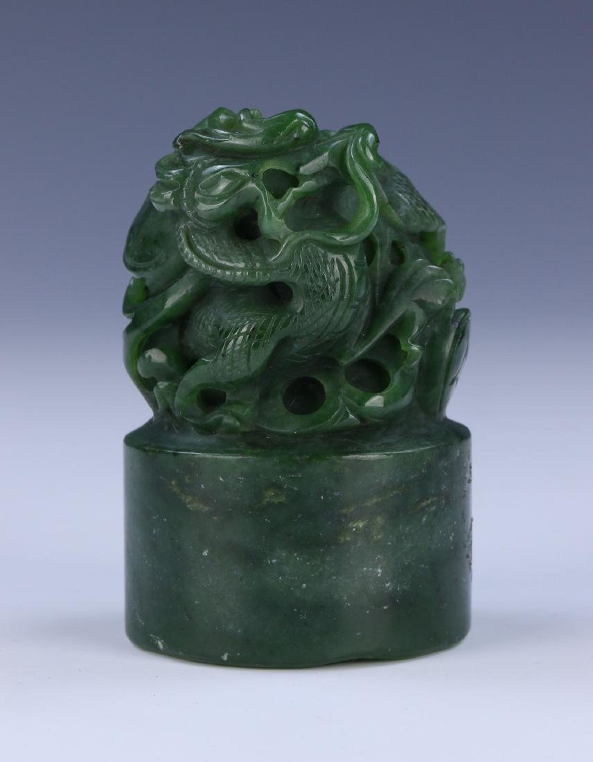 A CHINESE SPINACH JADE DRAGON SEAL