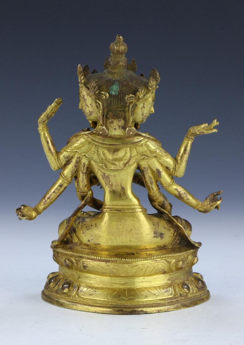 A CHINESE GILT BRONZE FIGURE OF GUANYIN WITH THREE FACE - 2